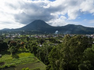 View of mount Lokon from pagoda of Buddhist temple with pagoda and statue in Tomohon (Sulawesi, Indonesia)