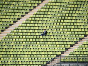 man alone in stadium