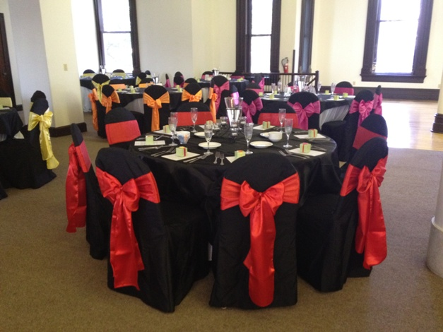 chair covers and tablecloth rentals diy dining pattern black with fuchsia, orange, yellow & red satin sashes | devoted weddings events