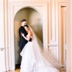 bride and groom in embrace in a hallway -Cairnwood Estate Wedding Shoot