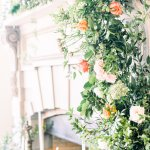fireplace mantel decorated with wedding flowers