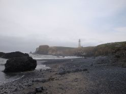 https://commons.wikimedia.org/wiki/File:Beach_View_of_Yaquina_Head_Lighthouse_-_Fog_Starting_to_Clear.JPG