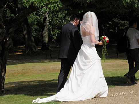 http://commons.wikimedia.org/wiki/File:Long_Wedding_Dress_for_Couple_with_Flowers.jpg