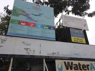 Signage promoting Anglicare's work at its Port Moresby office.