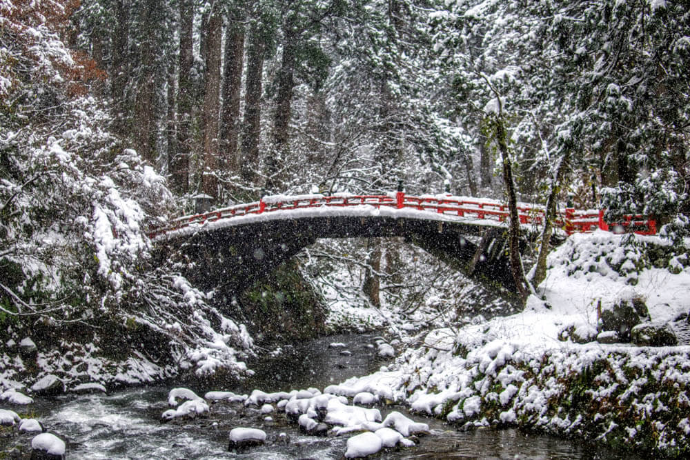 Shinkyo Bridge over the Haraigawa River at the base of Mt. Haguro of the Dewa Sanzan in the deep snow. Mt. Haguro can even be added to your Dewa Sanzan Hike in winter.