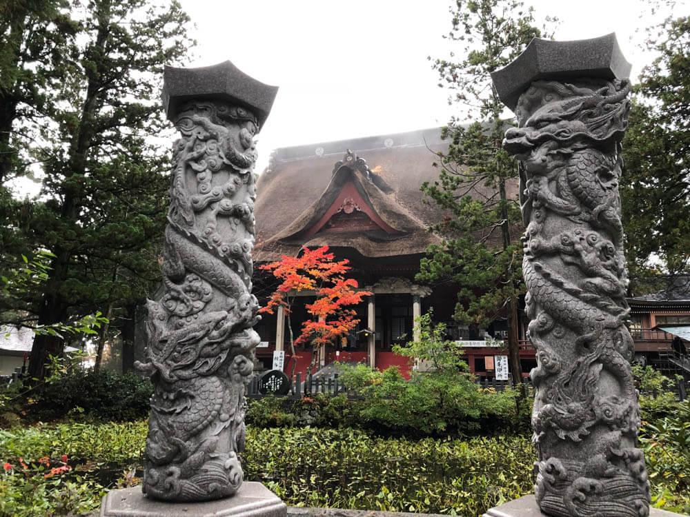 Sanjingosaiden Shrine and the Kagami'ike Mirror Pond at the top of Mt. Haguro of the Dewa Sanzan in Autumn