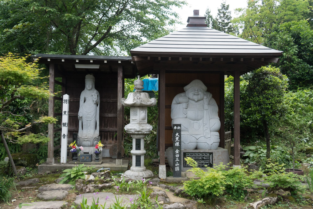 Buddhist Statues in the front garden of Daishinbo Shukubo Pilgrim Lodge on Mt. Haguro of the Dewa Sanzan