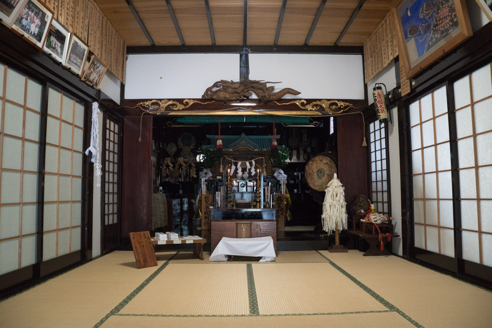 The Shinto Shrine and Buddhist Altar of Daishinbo Pilgrim Lodge on Mt. Haguro.