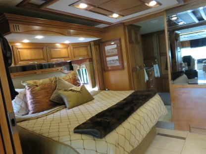 RV King Bed and o/h cupboards