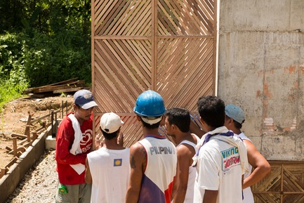 Press kit   3162-01 - Press release   Streetlight Tagpuro - Eriksson Furunes Architecture, Leandro V. Locsin Partners & Boase - Institutional Architecture -  The fathers evaluating the prototype design of the doors they made.<br>  - Photo credit:  Alexander Eriksson Furunes