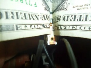 Cleaning copper contacts with a dollar bill
