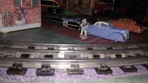 Nomura tin cars on train layout