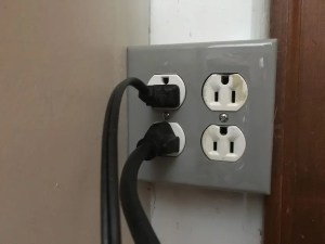 add an outlet to the garage from the adjacent room