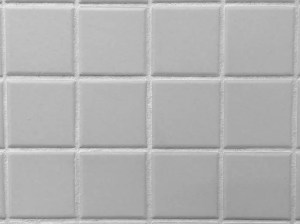 can you caulk over grout