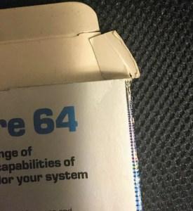gluing a tear in a game box