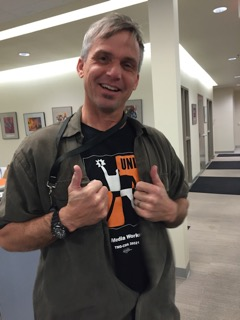 Monterey Herald photographer David Royal wears his Unite T-shirt with pride on his beat and in the newsroom. James Herrera