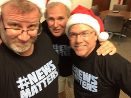 Guild members Chuck Pleiness, Jim Evans and Ray Skowronek of The Macomb Daily in suburban Detroit, wearing their #NEWSMATTERS shirts (plus Santa hats from a previous mobilizing event at that paper and sister paper, the Daily Tribune.)