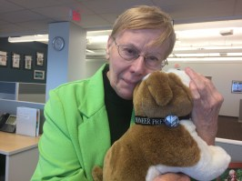 Mary Ann Grossmann, a Pioneer Press newsroom employee since 1961, cuddles a bulldog, the paper's mascot. Pooches know #newsmatters.