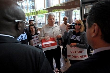 Investigative reporter Thomas Peele of the East Bay Times is stopped by building security attempting to deliver petitions to Alden Global Capitol at their headquarters in New York City, Tuesday, May 8, 2018. (Photograph by Karl Mondon)