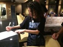 Elizabeth Hernandez of The Denver Post signs a group letter to Alden in New York City.   Julie Reynolds