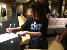 Elizabeth Hernandez of The Denver Post signs the group letter to Alden. | Julie Reynolds