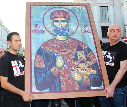 Sandro Bregadze (right) and supporters hold up a painting of Georgian King David IV
