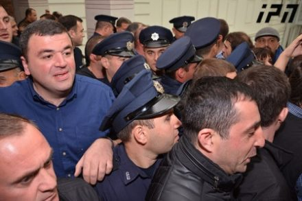 Tbilisi council members were forcibly dragged away before two controversial property plans were approved