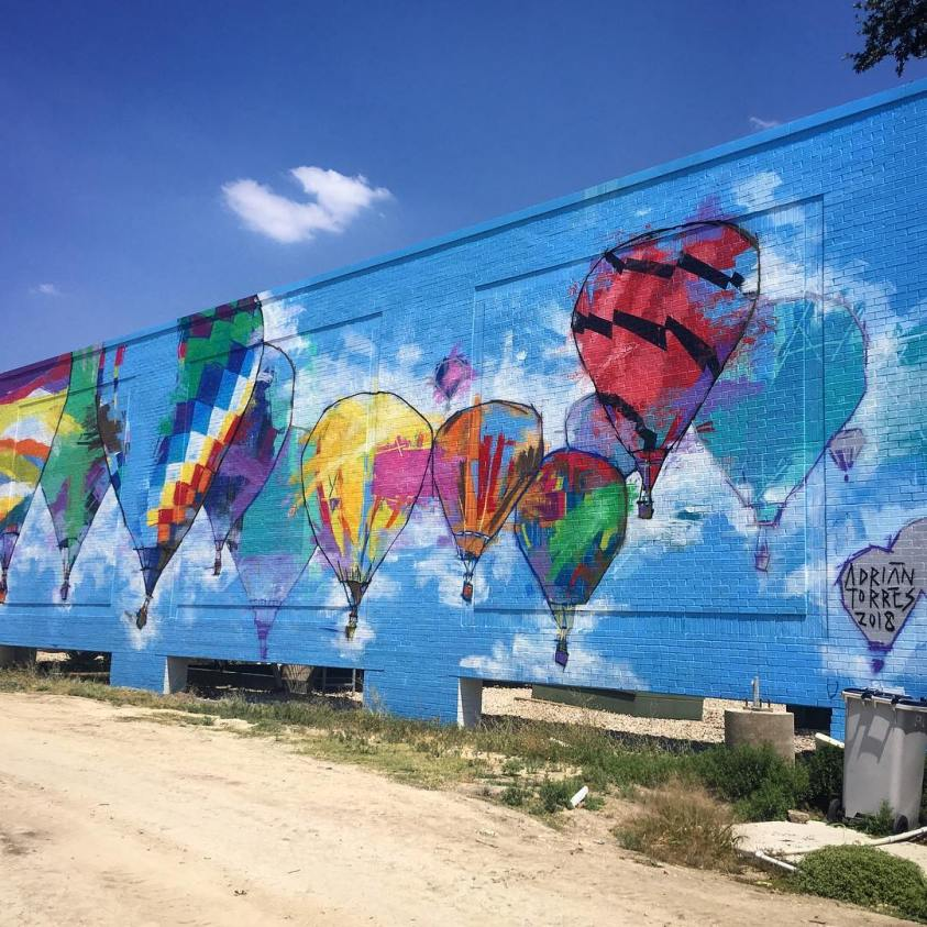 Adrian Torres' 2018 mural of hot air balloons at Legacy Central in Plano
