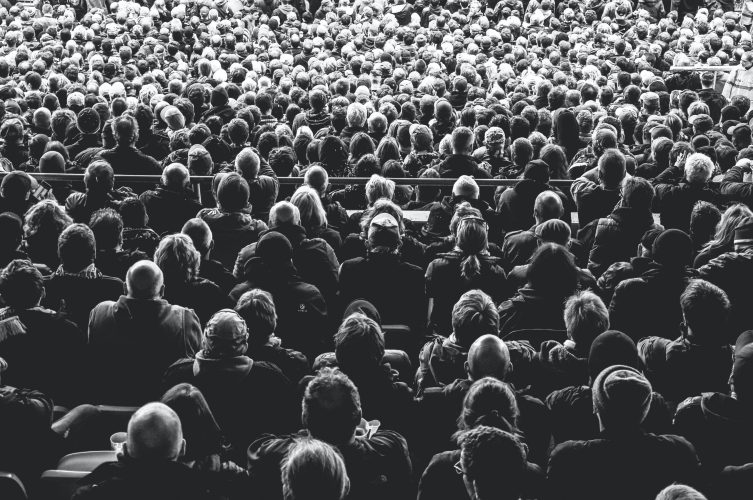 black and white photo of an audience from the back