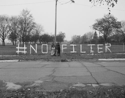 #NoFilter A Message in Nestle Water Bottles from Shea Cobb, Amber Hasan, Macana Roxie and LaToya Ruby Frazier at Sussex Drive and West Pierson Road, Flint MI, 2017