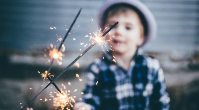 Child Holding Sparklers