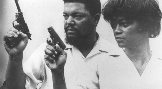 Robert and Mabel Williams holding pistols. Photo via Freedom Archives.