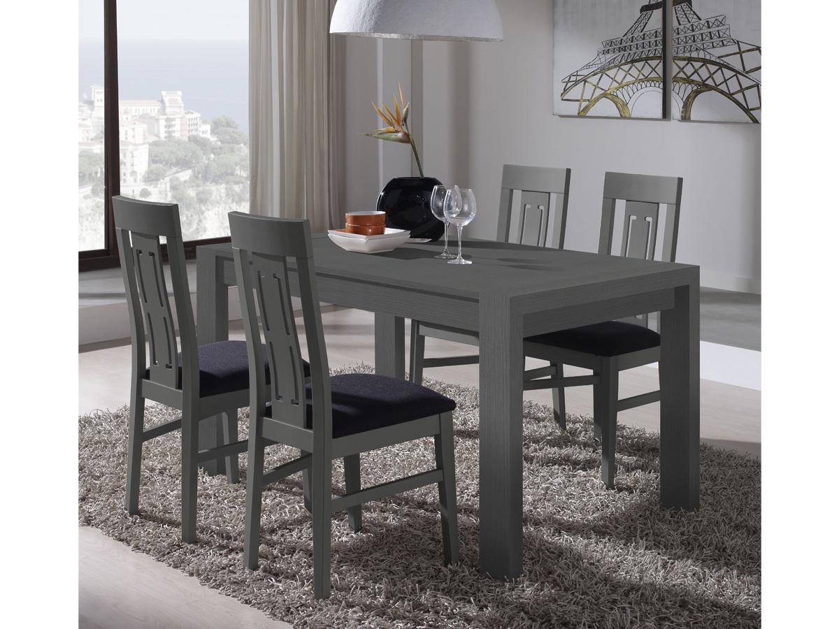 Saln comedor con mesa de madera y cristal con sillas