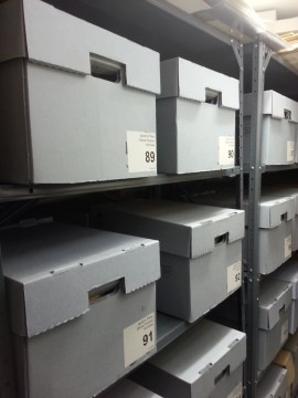 The documents and correspondence items are stored in these archival boxes.