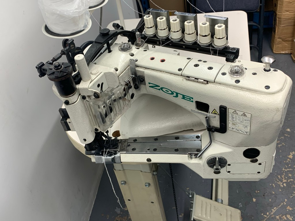 Zoje ZJ 35800 DNU High-Speed Feed-off-the-Arm Three Needle Chain Stitch for Cap Seaming.