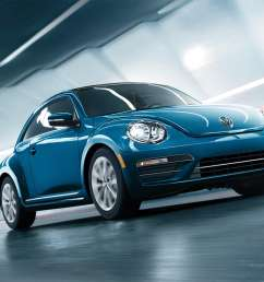 2019 volkswagen beetle final edition in blue driving down the road [ 1601 x 1067 Pixel ]