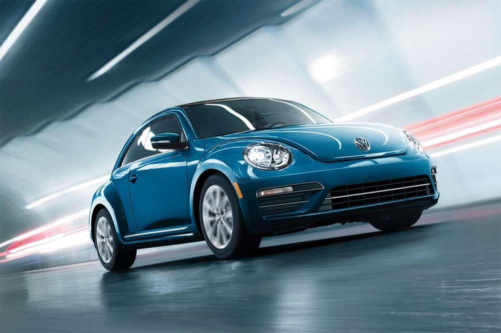 medium resolution of 2019 volkswagen beetle final edition in blue driving down the road