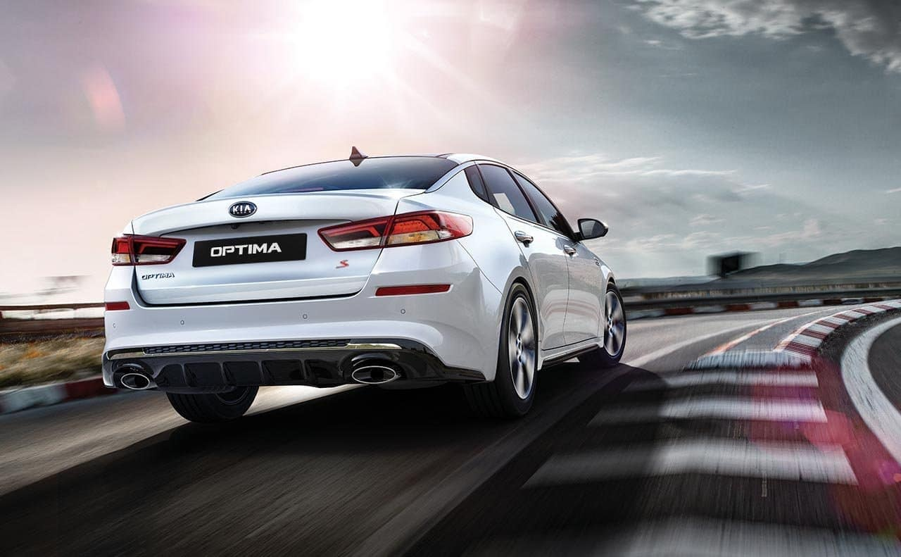 hight resolution of 2019 kia optima s in white racing down track