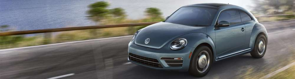 medium resolution of it s time to shift into excitement behind the wheel of the new 2018 volkswagen beetle showing off its iconic styling with fresh modern updates
