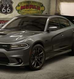 a 2018 dodge charger srt parked in a garage [ 1440 x 767 Pixel ]