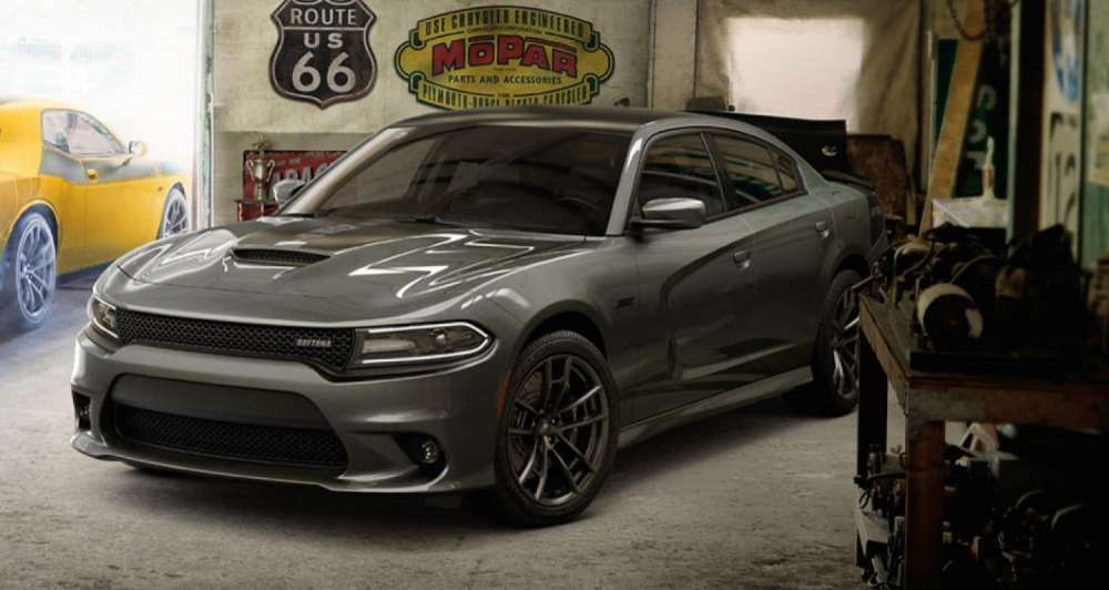 medium resolution of a 2018 dodge charger srt parked in a garage