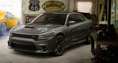 small resolution of a 2018 dodge charger srt parked in a garage