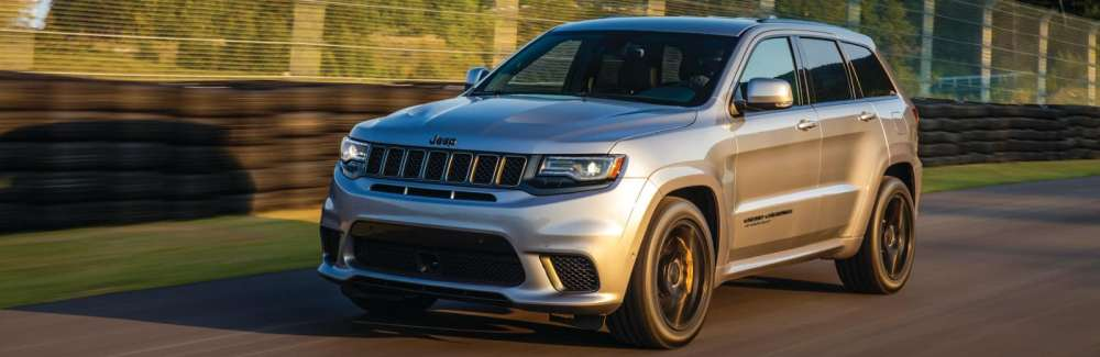 medium resolution of a jeep grand cherokee diving down an open track