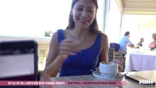 Talia Mint tests remote controlled toy in a public bar