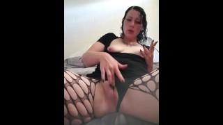 Goth chick smokes while masterbating with hairbrush