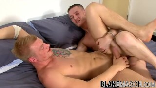 Inked hunk lays back and has his tight British hole drilled