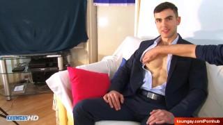 Handsome banker gets wanked his big cock in spite of him : Aleksander
