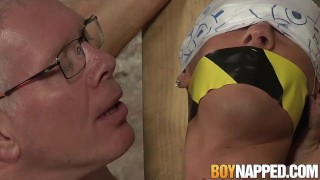 Restrained and blindfolded twink sub cock stroked by old dom