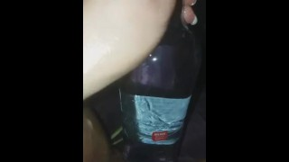Bottle in a loose pussy