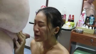 Thai girl plays with my cock and I piss in her mouth